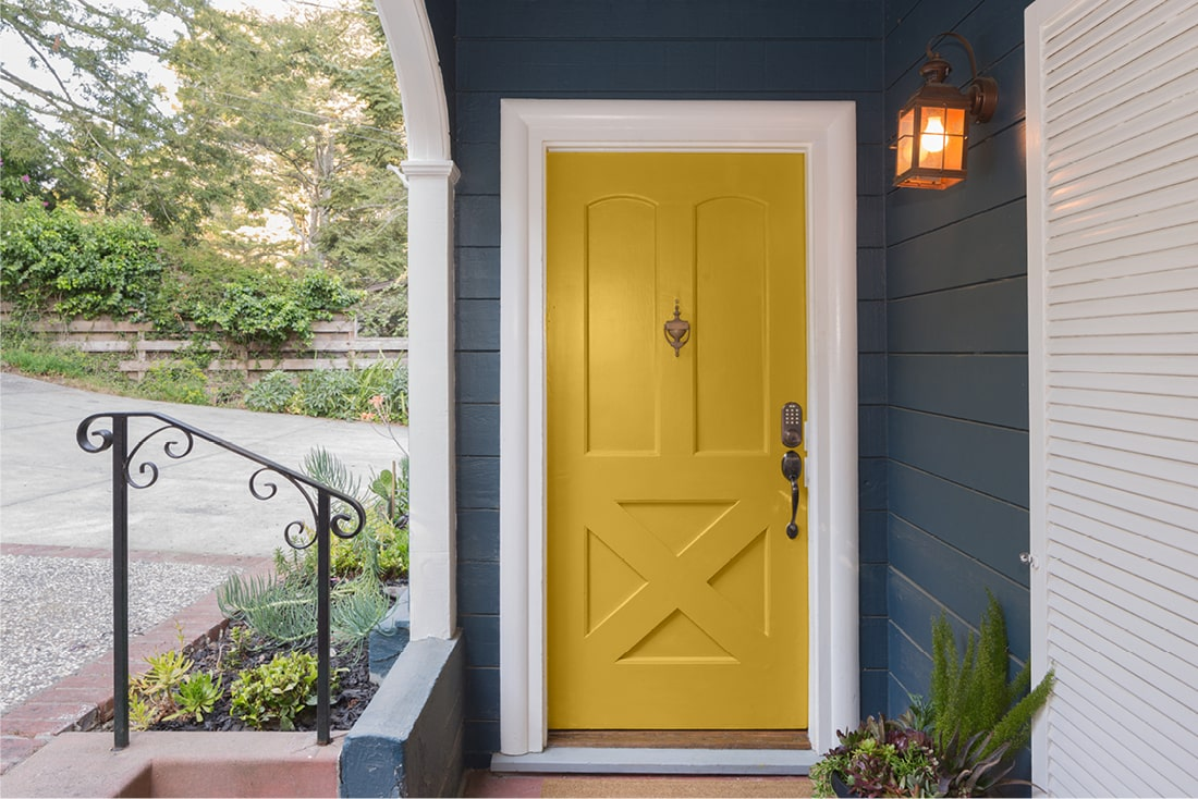 Yellow front door painted with Beauti-Tone paint