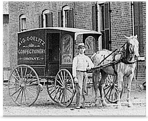 Gustav Goelitz's son with horse drawn cart of candy confections.