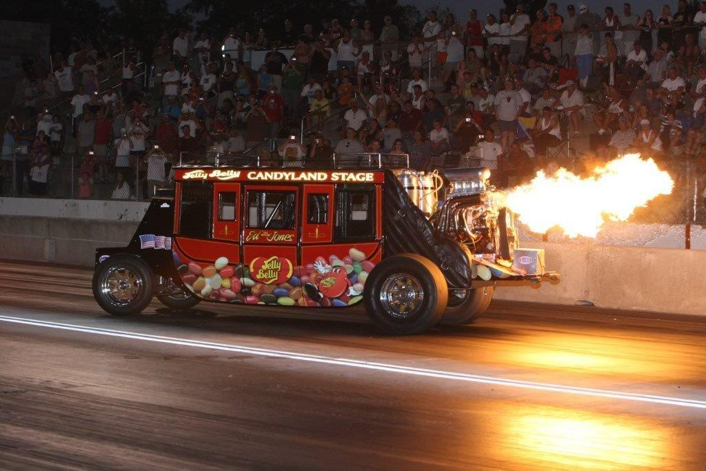 stagecoach on racetrack with flames